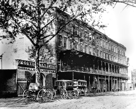 Old black and white photo of The Marshal House Savannah Hotel