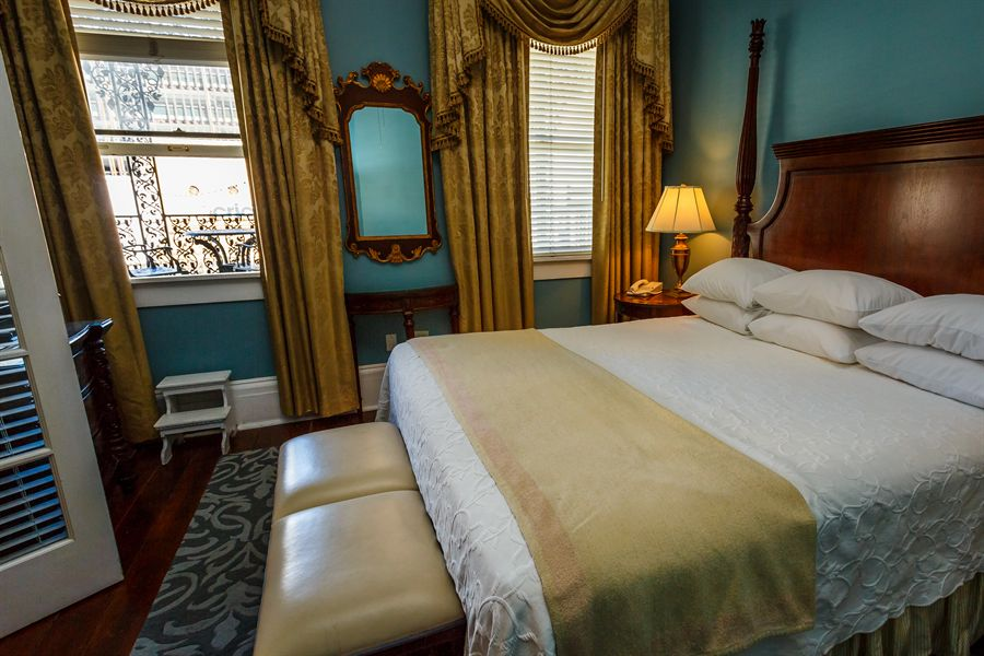 Luxurious King-sized bed and access to the Private Balcony from the Mary Marshall Suite.